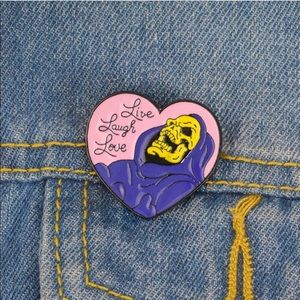 """Live, Laugh, Love"" Skeletor Enamel Pin"